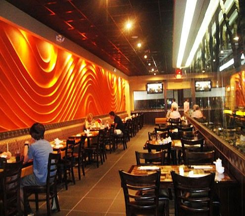 The restaurant itself is very large and has an industrial feel to it. One side feels like a sports bar with high tables and dual TV screens, and the other side has standard tables and cozy booths. #SushiCalgary
