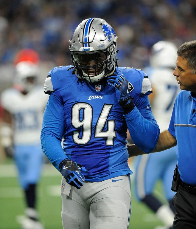 Detroit Lions defensive end Ezekiel Ansah (94) is escorted off the field during the first half of an NFL football game against the Tennessee Titans, Sunday, Sept. 18, 2016, in Detroit. (AP Photo/Jose Juarez)