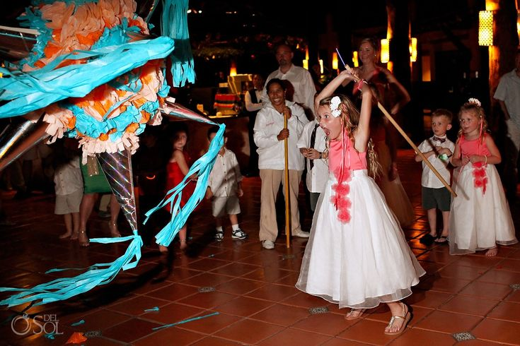 Destination Wedding Barcelo Maya Palace Mexico, how about a piñata at the reception? This little girl may look sweet but wow, she's going to really whack it! :D  Mexico wedding photographers Del Sol Photography @Ann Marie Kingó Hotels & Resorts