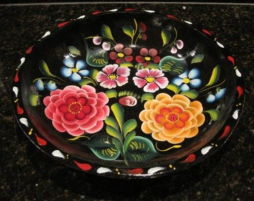 toll painted  - Bateas are wooden trays or bowls usually hand painted black and then toll painted with flowers or more rarely lake scenes. Most are made in Quiroga, Michoacán on Lake Patzcuaro and have been for generations. For more on Mexico visit www.mainlymexican...