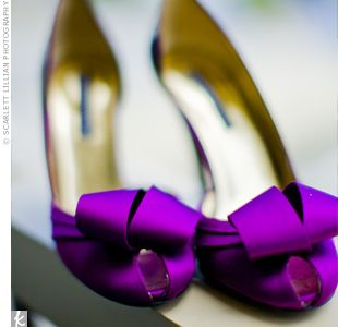 To brighten up her look, the bride chose purple, satin peep-toe pumps. Knots at the front of each shoe added a bit of flair.