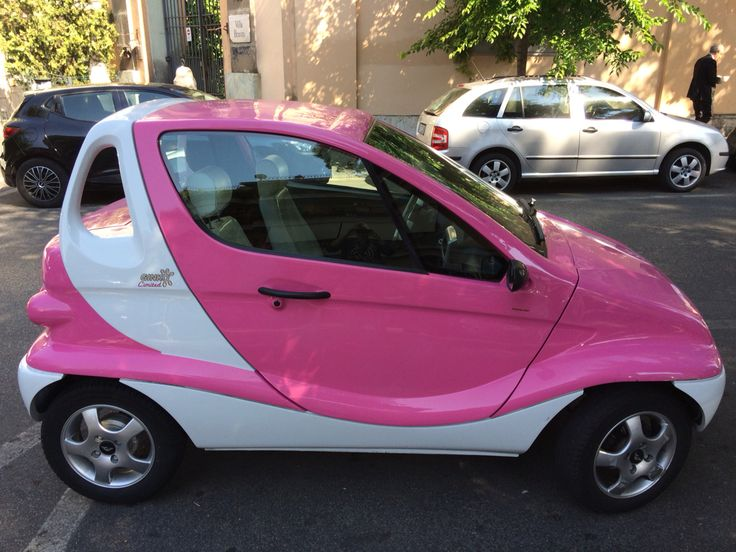 Perfectly #pink; a tiny two-seater #car spotted in Rome. I view these cars as covered motorbikes...it's what they are and just about as (un)safe. Adorable though!
