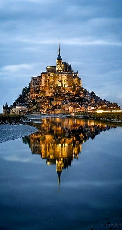 Mont Saint-Michel, Normandy, France.  Wow, this kind of looks like Tangled.