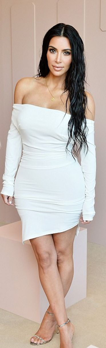 Who made Kim Kardashian's white off the shoulder dress and silver chain sandals?