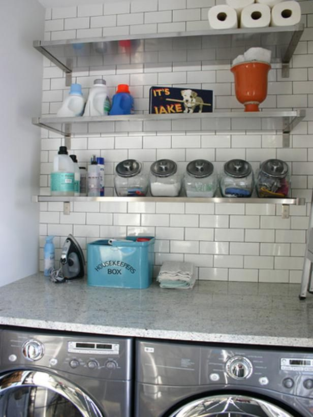 This laundry room uses materials that are equally functional and beautiful. Materials like tile and stainless steel are extremely durable and easy to clean. Designer Rebekah Zaveloff uses a smooth countertop above the appliances to add that extra surface, making it a dream laundry room.