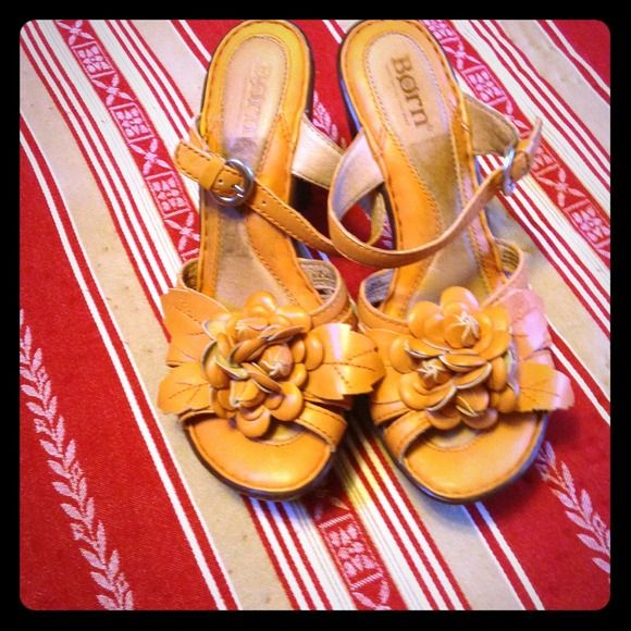 BORN orange strapy platform sandals BORN strapy sandals with comfortable padding. Gorgeous Floral leatherwork with tremendous detail. Sandals are a light orange color with a 5 inch platform in a size 6.  These are beauties.  These were only worn a couple of times on my honeymoon.  Even though the heel is a little high for me. I just couldn't help myself, I had to do a poolside fashion show. Please someone, buy these and enjoy them as much as I did, even if I  only wore them a few times, we…