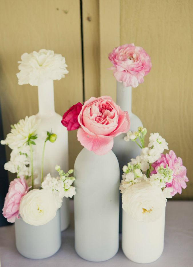 Empty Glass Bottles Fill In As Gorgeous Wedding Centerpieces.  @homedit
