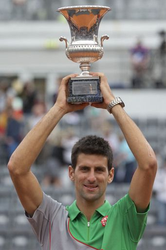Serbia's Novak Djokovic holds up the trophy after defeating Spain's Rafael Nadal at the final match of the Italian Open tennis tournament. (AP)