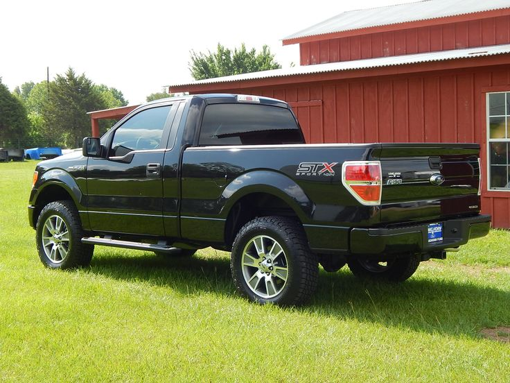 2014 Ford F150 STX Regular Cab 4X4. We added a leveling kit, custom window tinting, spray in bedliner and 20-inch Nitto tires. Does your F150 need a new look? #truckaccessories