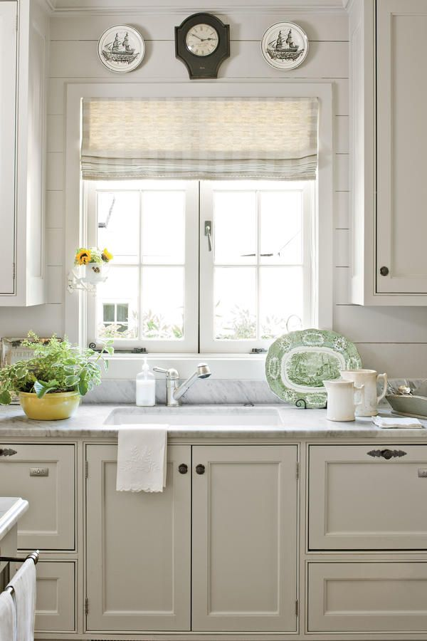 Cottage Details - Our Best Cottage Kitchens - Southernliving. Push-out casement windows and panked walls add to the kitchen's vintage feel.