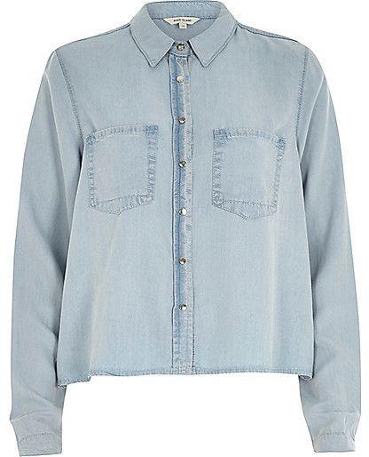 $64, Light Blue Denim Shirt: River Island Light Wash Crop Denim Shirt. Sold by River Island. Click for more info: https://lookastic.com/women/shop_items/154862/redirect
