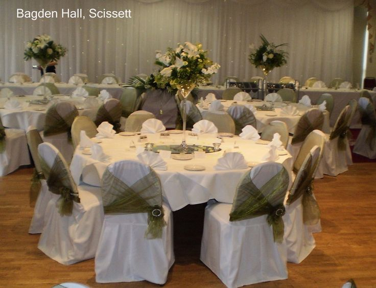 Bagden Hall - Orchard Suite -Cassandra's wedding reception. Linen chair covers with green organza sash. Martini vases with green & white floral arrangements. www.uniqueweddingflowers.co.uk