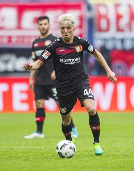 Leverkusen's Slovanian midfielder Kevin Kampl plays the ball during the German first division Bundesliga football match between RB Leipzig and Bayer 04 Leverkusen in Leipzig, eastern Germany, on April 8, 2017.  / AFP PHOTO / ROBERT MICHAEL / RESTRICTIONS: DURING MATCH TIME: DFL RULES TO LIMIT THE ONLINE USAGE TO 15 PICTURES PER MATCH AND FORBID IMAGE SEQUENCES TO SIMULATE VIDEO. == RESTRICTED TO EDITORIAL USE == FOR FURTHER QUERIES PLEASE CONTACT DFL DIRECTLY AT + 49 69 650050.