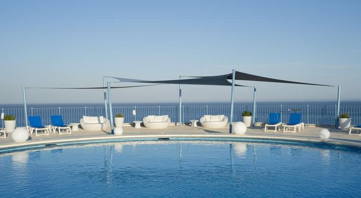 Hotel El Puerto by Pierre Vacances Fuengirola Hotel El Puerto by Pierre Vacances is situated just 50 metres from Fuengirola Beach, and 300 metres from Fuengirola Bus and Train Station. The rooftop pool offers panoramic views of the Costa del Sol.