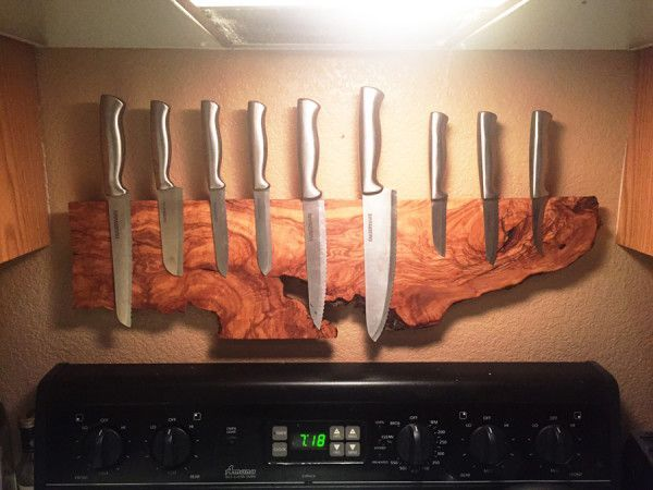 Old wood embedded with magnets, then mounted on the wall — where great art should be hung — and knives were added.