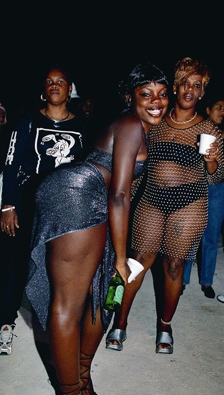 Dancehall girls dress to excess with plenty of bling and flesh at ragamuffin events in London's West End in 2004.