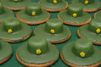 Army soldier hats... Marie biscuits with marshmallows on top and a little candy star stuck to the green icing