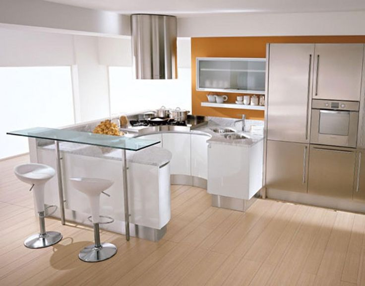 Brilliant modern kitchen design with ergonomic feature glass serving table in front of chic modern