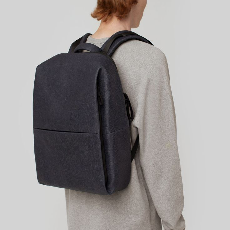 """The côte&ciel Rhine Denim Rucksack in a robust waxed indigo denim is an ergonomically styled backpack that's both compact and discreet.  Flat when empty, the Rhine's minimalist silhouette makes it a perfect stowaway - yet it can comfortably store a laptop of up to 15""""."""