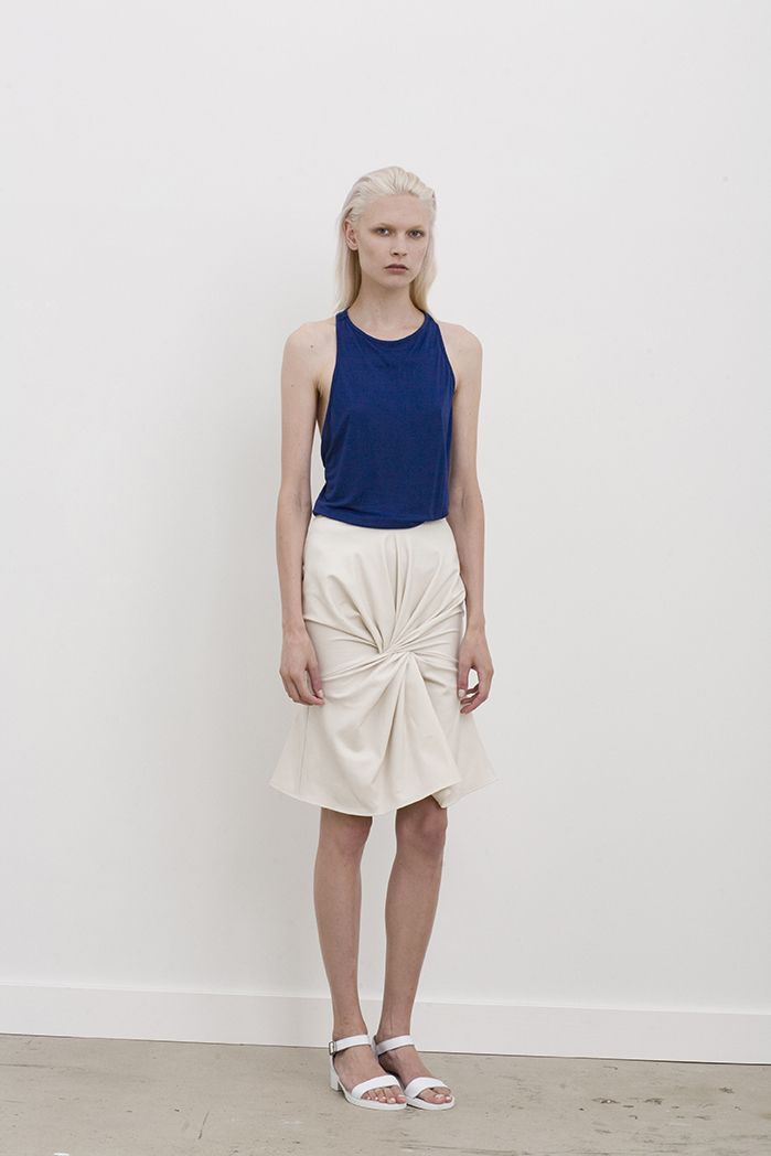 Filda racer back singlet worn with Davis high waisted skirt with twist