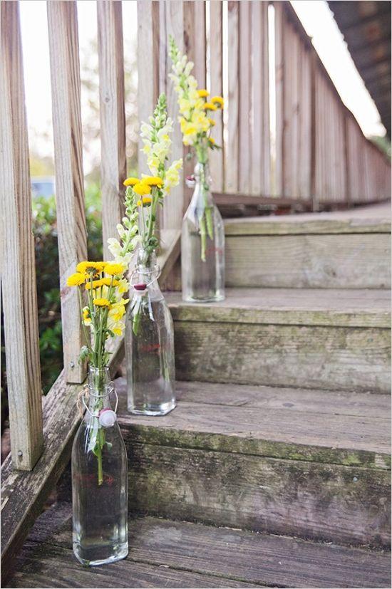 wildflowers in glass bottles brighten up a staircase #weddingdecor #diy #weddingchicks http://www.weddingchicks.com/2014/02/10/i-heart-fall-wedding-inspiration/