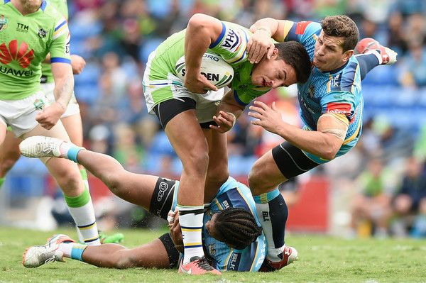 Joseph Tapine of the Canberra Raiders is tackled during the round 16 NRL match between the Gold Coast Titans and the Canberra Raiders at Cbus Super Stadium on June 26, 2016 in Gold Coast, Australia.