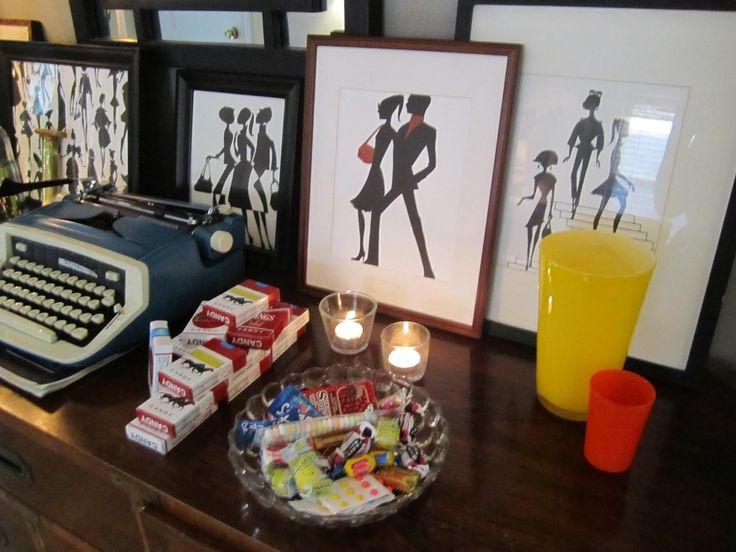 decor for a Mad Men party: typewriter, candy cigarettes, candy from the 60's, vintage prints