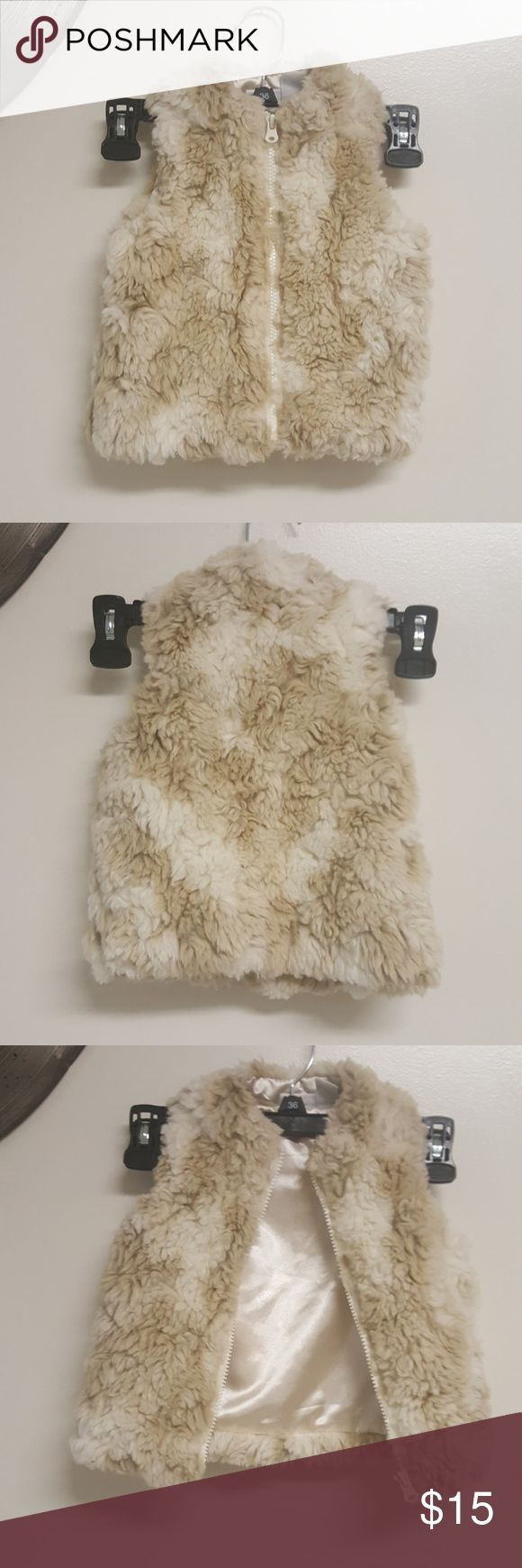 Kids R US coat vest Room for Bargaining  This very is super furry and soft on the outside and smooth and silky on the inside. This does keep you kid warm too. There are no stains on the inside or out  This could be worn on you little girl with a cute long sleeve some boots and cute winter leggings. kids r us Jackets & Coats Vests
