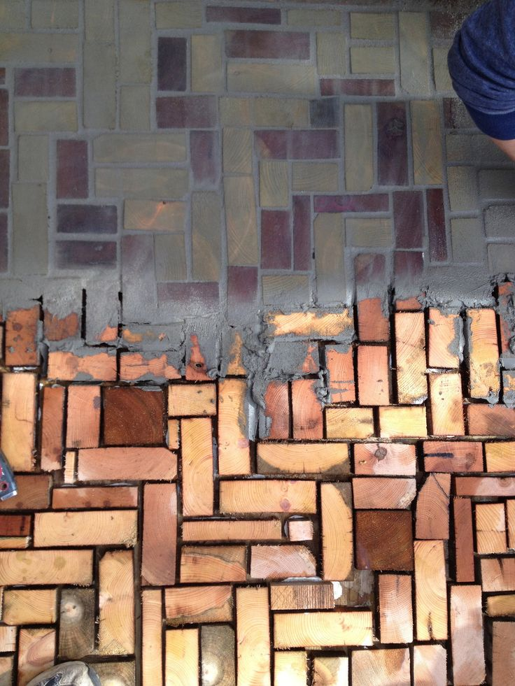 "diy: cut the ends off wood planks to make wood ""bricks."" Grout them with cement, or leave the natural finish in outdoor living spaces."