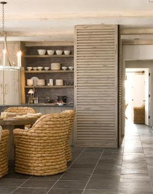 We can get behind these great old shutters, unexpected dining chairs and pottery shelving.