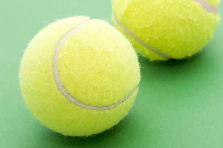 Free Stock Photo: two tennis balls on a green background - By freeimageslive contributor: stockmedia.cc