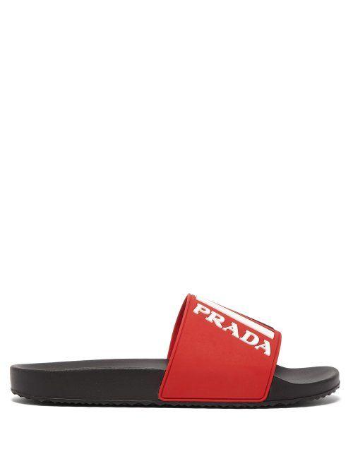 2f4eea2256905 PRADA PRADA - LOGO EMBOSSED RUBBER SLIDES - MENS - RED MULTI.  prada  shoes