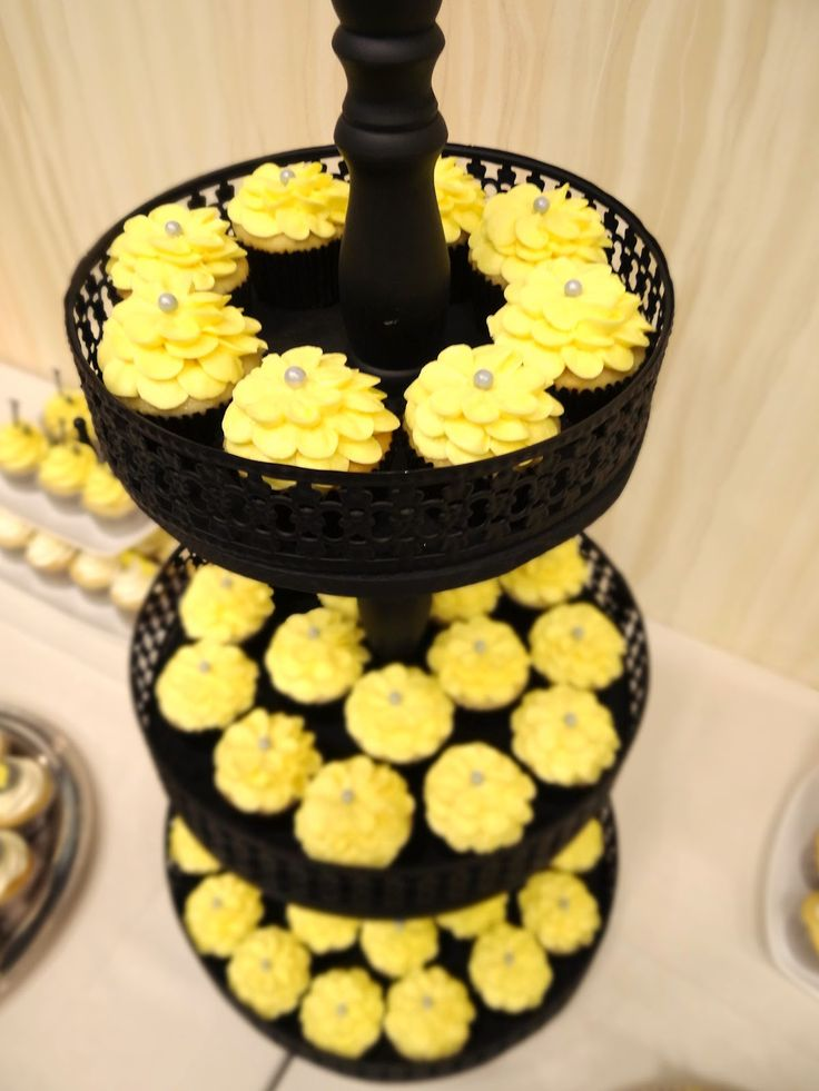 Grey+and+Yellow+Wedding+Cupcake | Huge tower of yellow petal flower cupcakes with a large gray edible ...