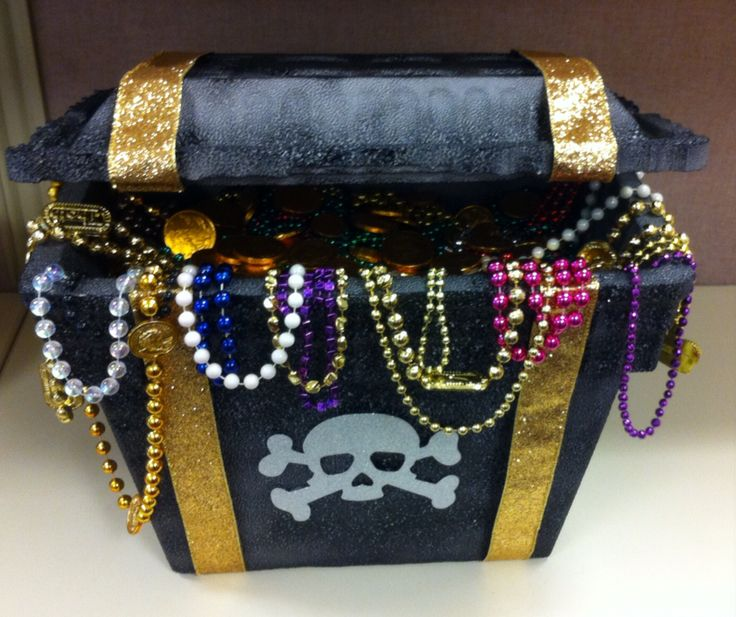"""DIY Pirate's Treasure Chest - all you need is a foam cooler, two small gold hinges, black spray paint, 12ft gold ribbon, two small pieces of wire or two toothpicks, super glue, tape, assorted beads, gold coins and any other """"treasure"""" you'd like to add!"""