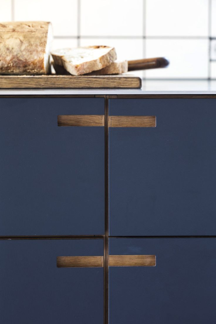 blue painted drawer fronts and integrated pulls cut outs for handles