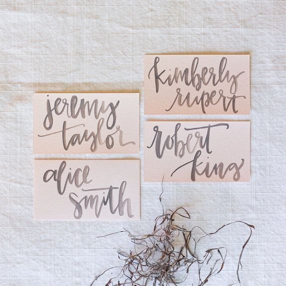 Grey watercolor calligraphy on blush place card fab
