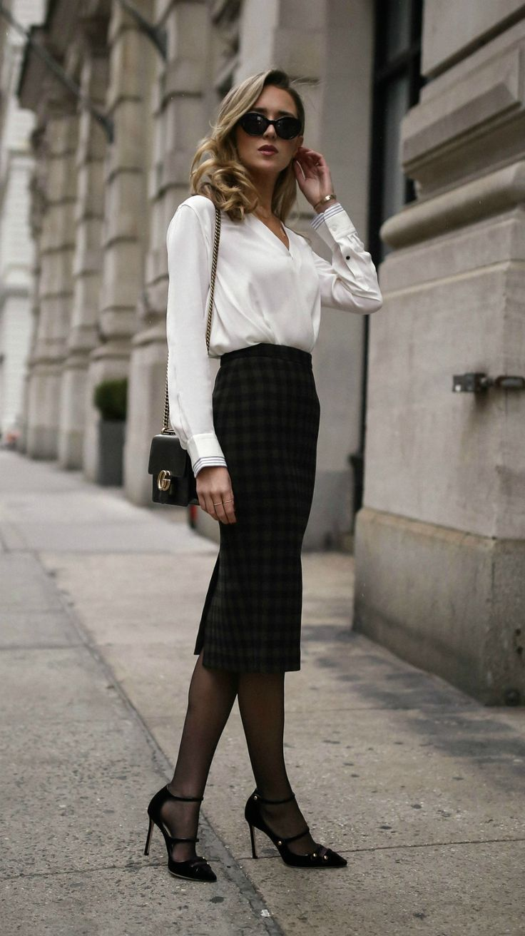 The Jewelry Brand Every Working Girl Needs To Know // Classic white blouse, plaid midi skirt, black strappy Mary Jane pumps, cat eye sunglasses, geometric bar earrings, geometric bar necklace, diamond pendant necklace, gold tribar cuff and a black leathe