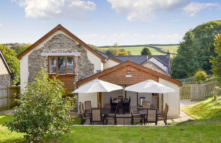 6 bedroom luxury holiday cottage. Exterior with outdoor seating  | Buckland Barn, Buckland Brewer, near Bideford