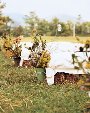 This couple used hay bales and wild flowers in their fall wedding