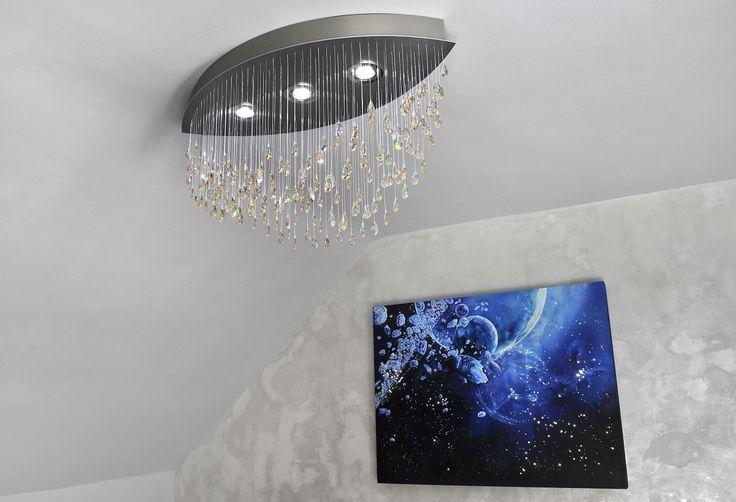 Modern chandelier made of crystals hanging on sparkling fiber optics. Serial production. MADE WITH SWAROVSKI ELEMENTS.