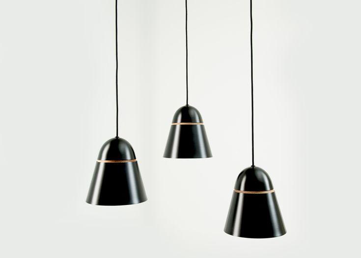 Aluminium and timber light shades use gravity to maintain shape