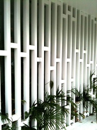 Timber screen - security and privacy under a building