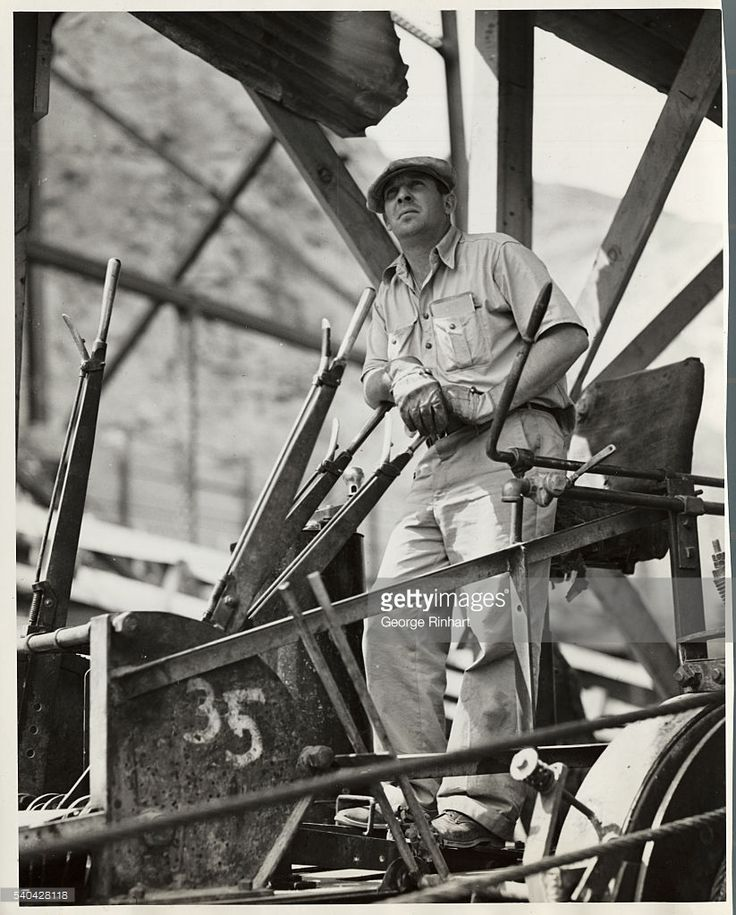 Control man. In his cab, with many levers and brakes, this operator controls the drums for the accurate placing of steel members, some weighing 38 tons, of the new construction trestle at Grand Coulee Dam, being built by the Bureau of Reclamation on the Columbia River, Washington.