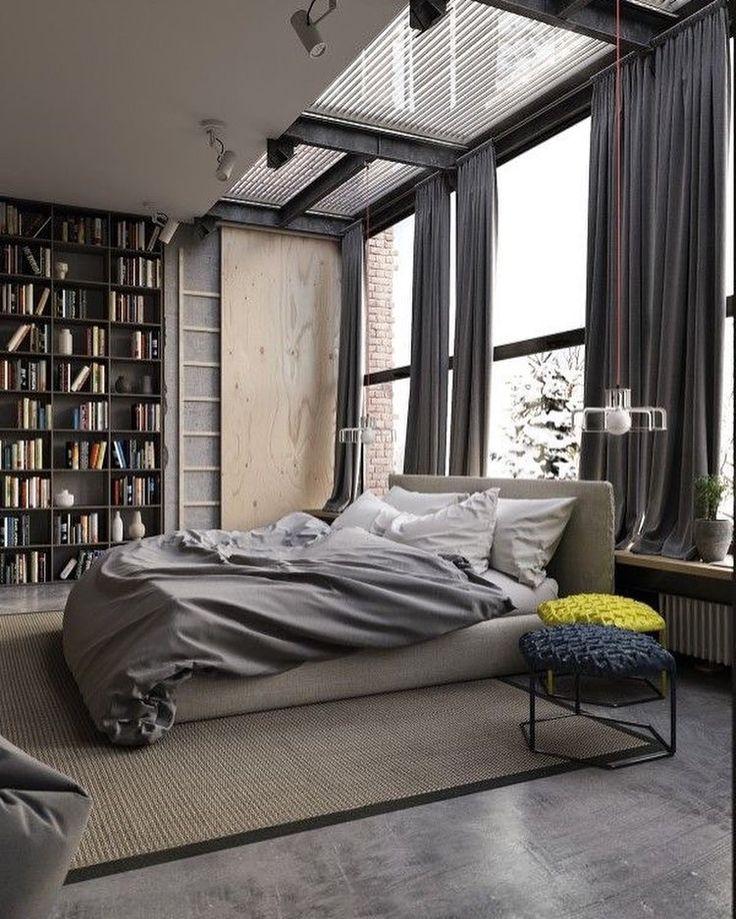 Uma decoração minimalista, livros, conforto, luz natural e grandes janelas de vidro.