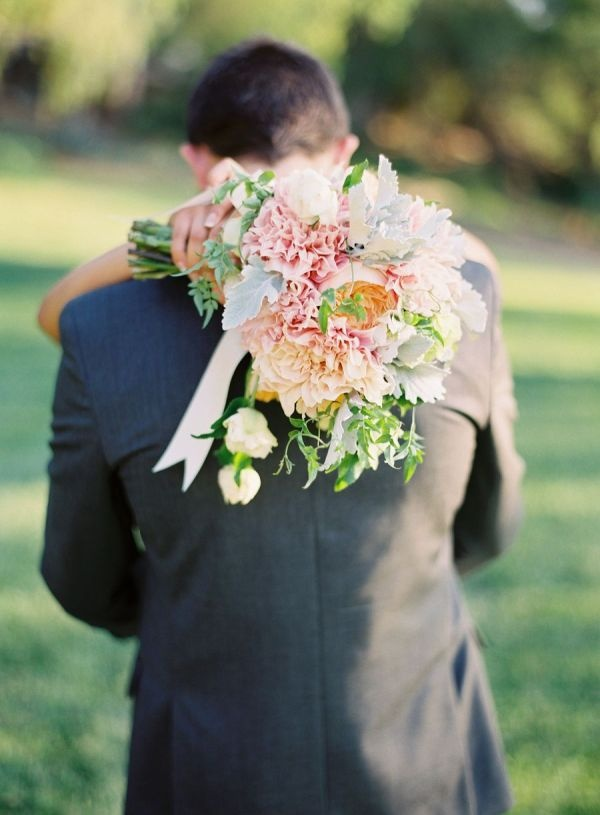 I think this shot of the groom & bride is adorable. Def. want my photographer to do this..
