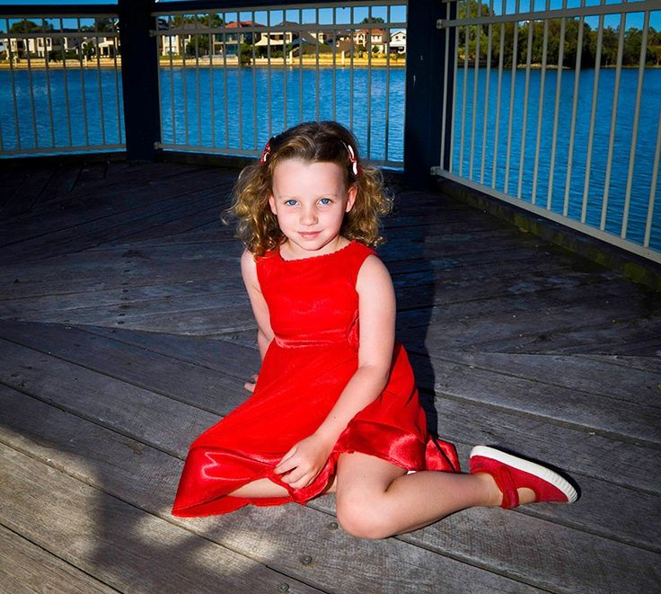 """Kate - So cute!! This elegant dress from Elfin Kidz is sure to give your angel a look that will make you go """"awwee"""". With a charming rose accent, delicate lacing on the neck, satin tie ups and double layered sleek fabric, it is simply beautiful."""