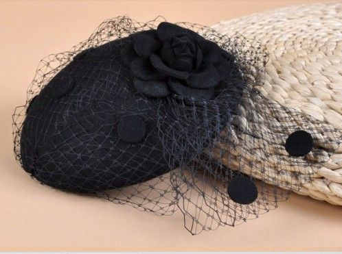 """Charlotte"" Black Fascinator A cute and quirky wool felt hat, designed to be worn slightly tipped with lace net detail that is swept to the side and featuring a matching felt flower. The hat and net are also dotted with matching felt circles. Gorgeous! $79.95 including gift box and FREE shipping in Australia."