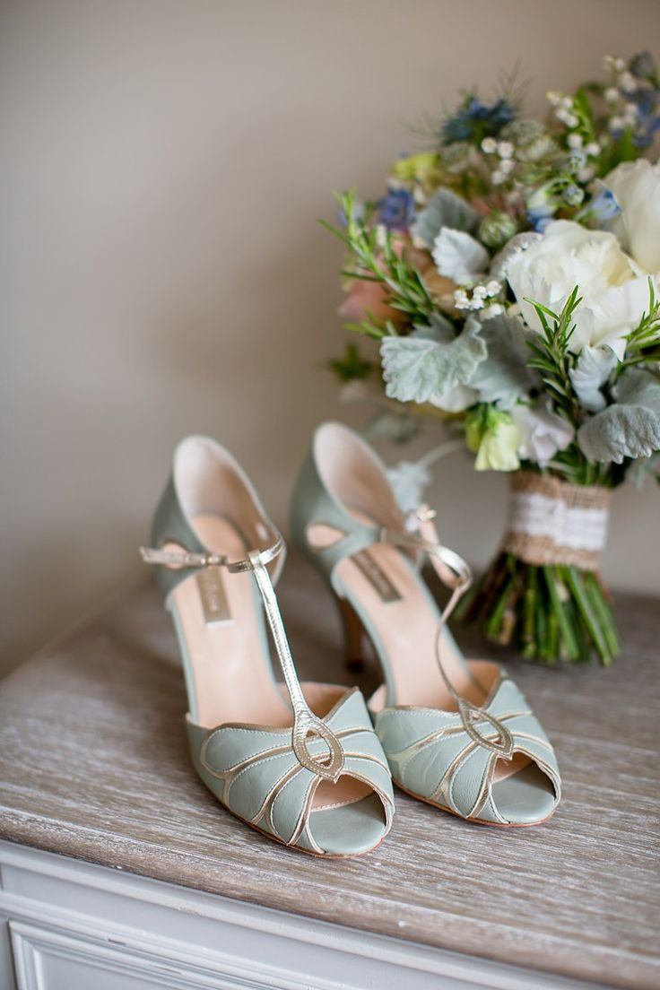 Kara wore Rachel Simpson Mimosa Shoes in pale mint leather.  The T-bar sandal has a unique petal design and champagne gold leather trim! See how she styled them:   http://whimsicalwonderlandweddings.com/2016/04/southwood-hall-natural-soft-stylish-meets-luxe-wedding.html