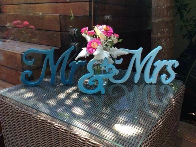Aqua wooden painted Mr and Mrs wedding signs and bright flowers by The French Petal, Byron Bay