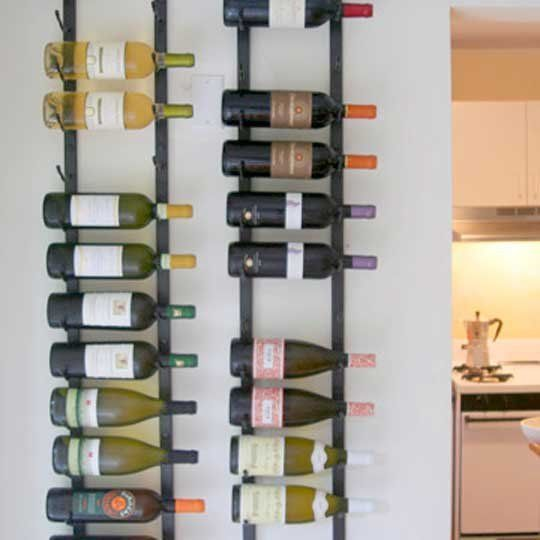 Like Wine? Like seeing your wine? Like storing it really efficiently?   I stumbled across these vertical flat wine racks about two years ago and have installed them in our home. They are awesome for wine storage when you want to consume fairly soon - not for storing wine in your cellar. We seem to empty the racks too often :-). Here they are in my house. Here they are at Cafe Falai, where I first saw them.